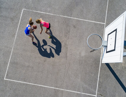 Young women playing basketball, aerial view - STSF01604