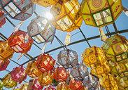 Rows of sunlit lanterns honoring buddhas birthday in Naksansa Temple, Naksansa, Yangyang, Gangwon province, South Korea - CUF28399