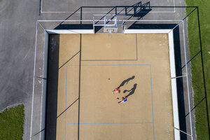Young women playing basketball, aerial view - STSF01615