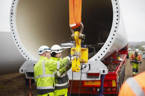 Engineers working on wind turbine - CUF28479