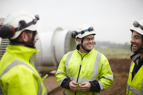 Engineers having conversation at wind farm - CUF28494