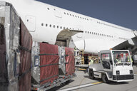 Ground crew loading A380 jet aircraft at airport - CUF28743