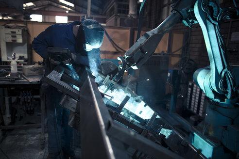 Welder welding metal with robot - OCAF00291