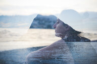 Double exposure of woman looking out at Lake Lugano, Switzerland - CUF29747