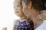 Close up of female toddler and father face to face - CUF29843