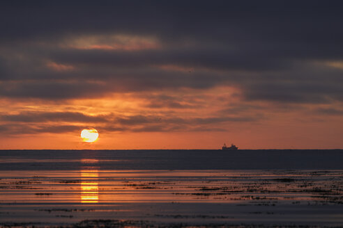 Seascape with silhouetted ship on horizon at sunset, Reykjavik, Iceland - CUF29909