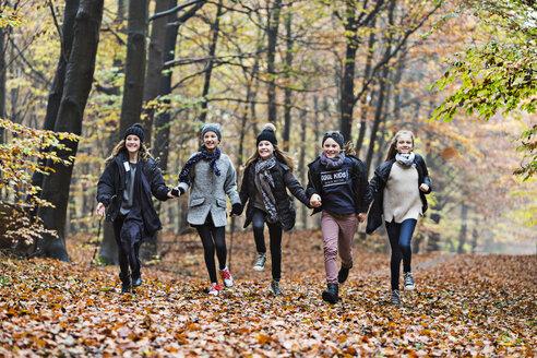 Girls running in autumn forest - CUF30517