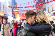 Romantic young couple hugging, Chinatown, London, England, UK - CUF30781