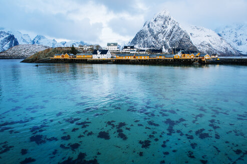Reine fishing village with snow capped mountains, Norway - CUF31072