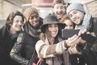 Six young adult friends taking selfie on smartphone - CUF31153