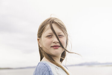 Portrait of a girl with windswept hair, Thingvellir, Iceland - CUF31180