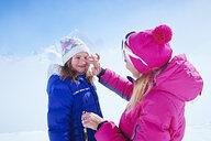 Mother applying sun cream on daughter's face, Chamonix, France - CUF31267