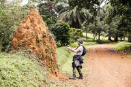 Uganda, Entebbe Botanic Gardens, Tourist taking pictures of - REAF00329