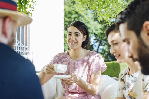 Group of friends having tea together, outdoors - CUF31464