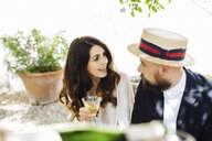 Mid adult couple drinking champagne, outdoors - CUF31473