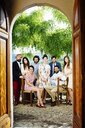 Portrait of group of friends, outdoors, photographed through doorway - CUF31485