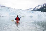 USA, Alaska, Valdez, man in canoe on glacial lake - CVF00816