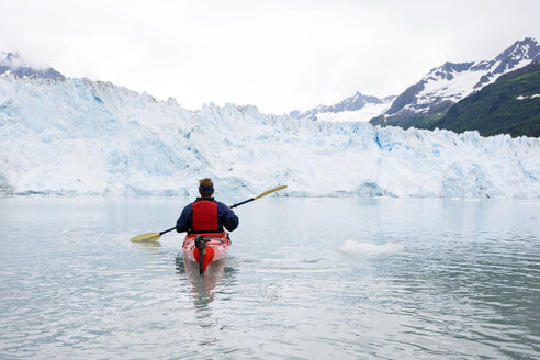 USA, Alaska, Valdez, man in canoe on glacial lake - CVF00816