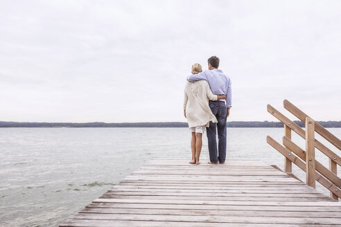 Mature couple standing on pier, looking at view, rear view - CUF31612