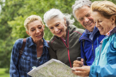 Group of friends, hiking, looking at map - CUF31651