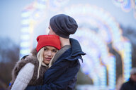 Romantic young couple at xmas festival in Hyde Park, London, UK - CUF31762