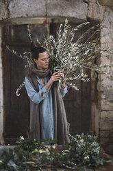 Woman arranging twigs - ALBF00479