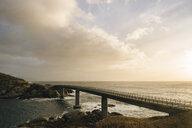 Silhouetted bridge on coastline, Reine, Lofoten, Norway - ISF09821