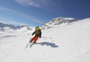 Young boy skiing downhill, low angle view - ISF10028