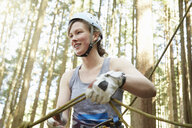 Rock climber preparing safety harness - ISF10181