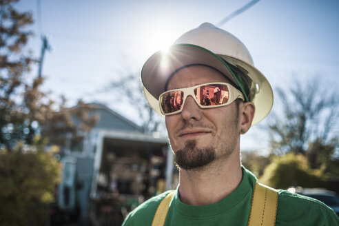 Portrait of solar panel installation crew member - ISF10232