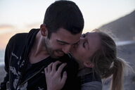 Couple hugging on beach, Malibu, California, USA - ISF10280