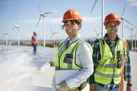 Portrait confident engineers at alternative energy power plant - CAIF20768