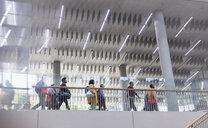 Business people walking on modern office balcony - CAIF20906
