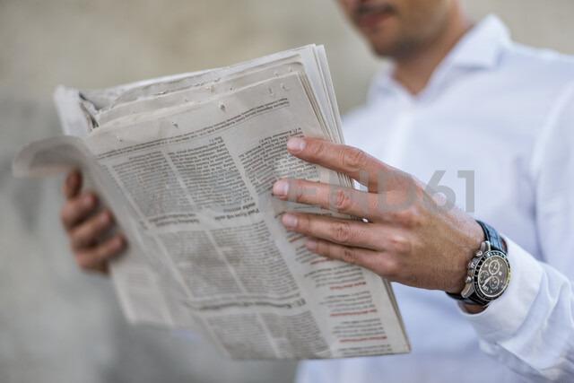 Close-up of businessman reading newspaper - DIGF04708