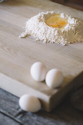 Wheat flower and semolina with egg yolk on pastry board - ALBF00488