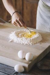 Woman preparing pasta dough, flour and eggs - ALBF00491