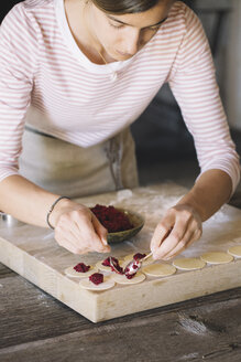 Woman preparing ravioli, beetroot sage filling - ALBF00503