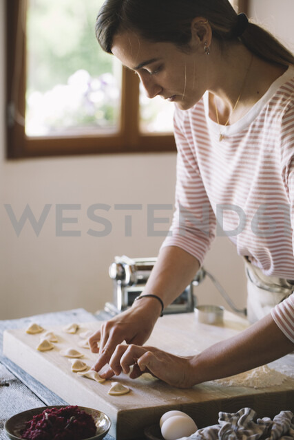 Woman preparing ravioli, beetroot sage filling - ALBF00506