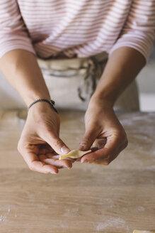 Woman preparing ravioli - ALBF00512