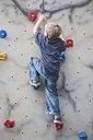 Young boy climbing on climbing wall - CUF32509