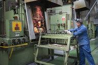 Engineer heat treating gear wheels in engineering factory - CUF32602