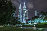 Petronas Towers illuminated at night, Kuala Lumpur, Malaysia - CUF32710