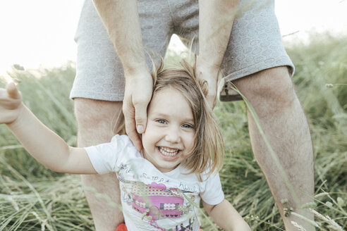 Portrait of happy little girl with father in nature - KMKF00374