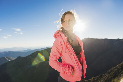 Portrait of young female trail runner on Pacific Crest Trail, Pine Valley, California, USA - ISF10597