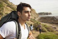 Young man, at beach, looking at view - ISF10768