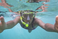 Woman snorkelling - ISF10831