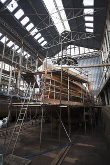 Scaffolding and boat in shipyard workshop - ISF10978