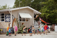 Large group of children and teacher returning to sea school, Sanibel Island, Pine Island Sound, Florida, USA - ISF11488