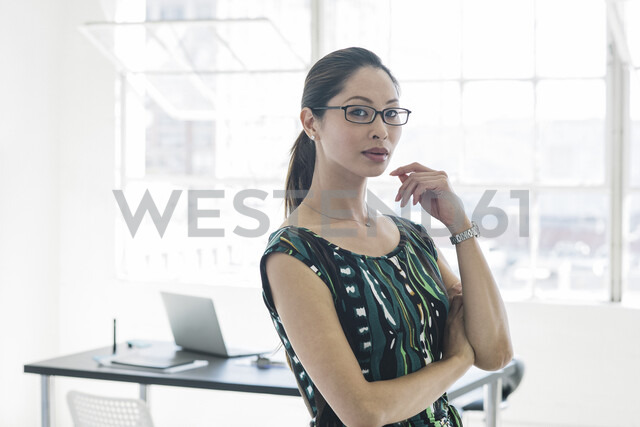 Bespectacled businesswoman in patterned dress by office window - ISF12034 - Corey Jenkins/Westend61