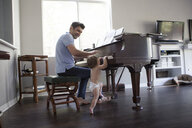 Father and baby boy playing on piano - ISF12487